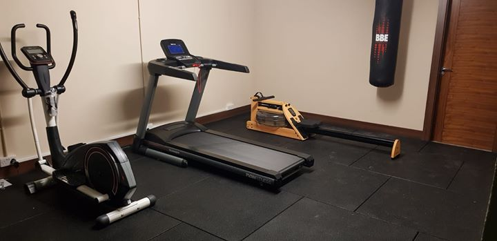 Look at this beautiful home gym and rubber flooring that we